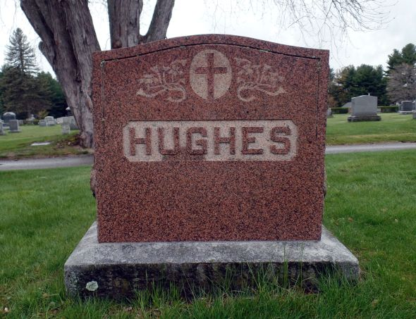 The grave of Gunner John Francis Hughes and his parents